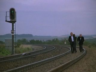 Walking along the track in 'Minder On The Orient Express'