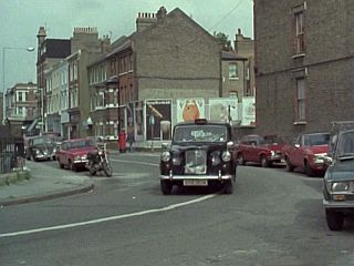 Approaching Norman Gibbons Garage in 'Aces High And Sometimes Very Low'